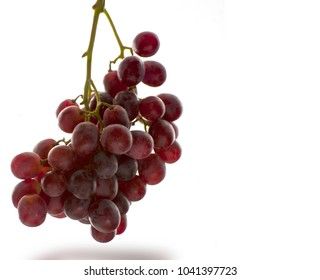 Bunch of ripe red grapes isolated on white background and bottom shadow reflection