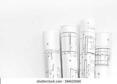 Bunch of rolled up building plans and technical drawings