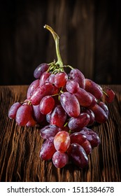 bunch of rose grape on vintage wooden board