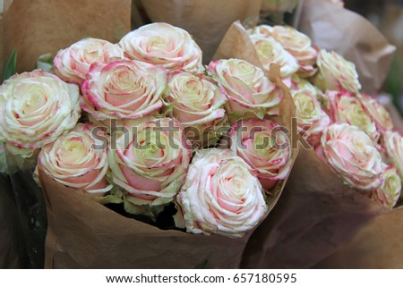 Bunch roses flowers wrapped brown paper stock photo edit now bunch of roses flowers wrapped in brown paper florist bouquet pastel colors mightylinksfo