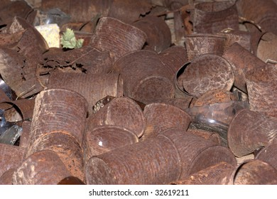 Bunch of rusted cans laying on the ground