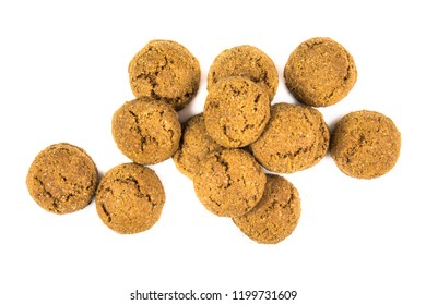 Bunch of scattered pepernoten cookies and sweets from above on white background for annual Sinterklaas holiday event in the Netherlands on december 5th