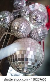 A bunch of small decorative mirror balls or disco balls.