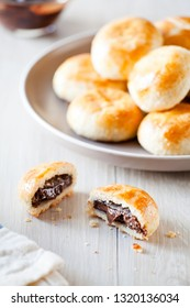 Bunch of small homemade french brioche with chocolate
