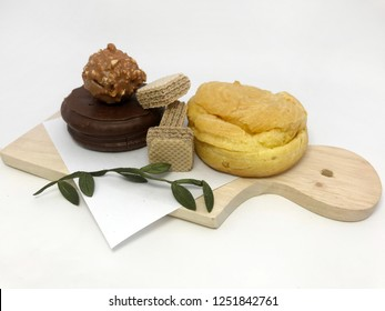 A bunch of snacks with wooden plate