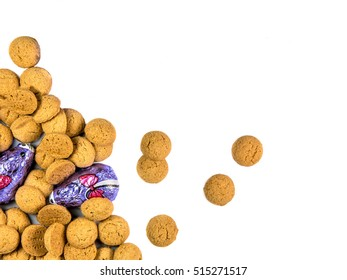 Bunch of spread Pepernoten cookies and chocolate mice as Sinterklaas decoration on white background for dutch sinterklaasfeest holiday event on december 5th