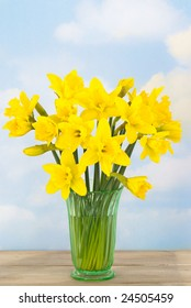 Bunch of spring daffodils in rustic setting