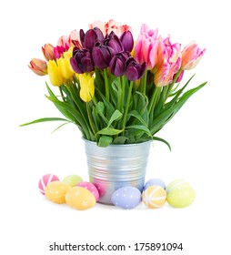 Bunch  of spring   tulips flowers with easter eggs   isolated on white background