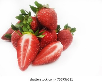 Bunch of strawberries isolated on white background. Selective and soft focus applied.