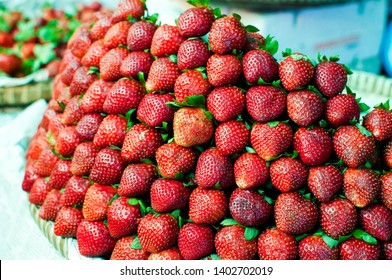 bunch of strawberries on display