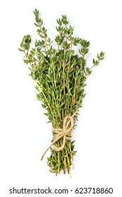 Bunch of thyme tied with twine, isolated on white.