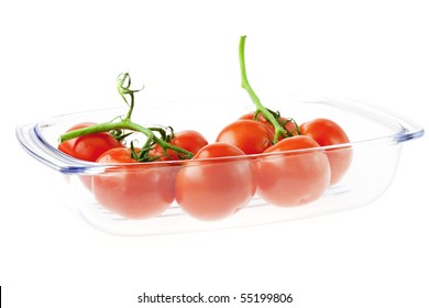 a bunch of tomatoes in a glass isolated on white