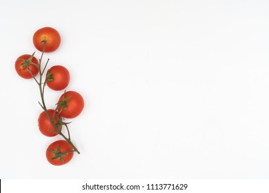 a bunch of tomatoes on a white table