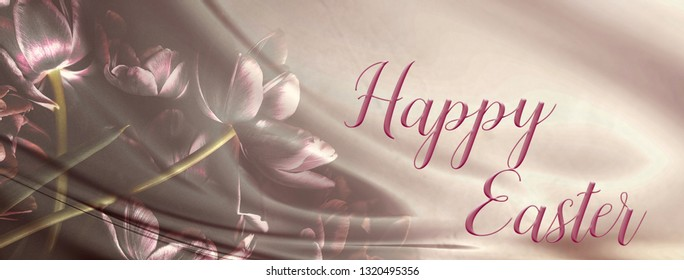 Bunch of tulips on an abstract backdrop with silk fabric.  Happy Easter quote.