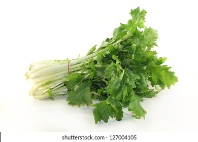 a bunch turnip greens on a white background