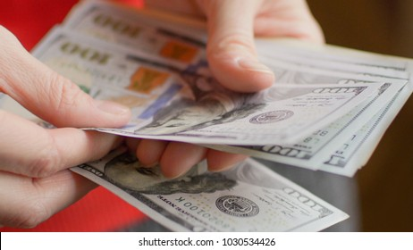 Bunch of US Dollar in the female hand