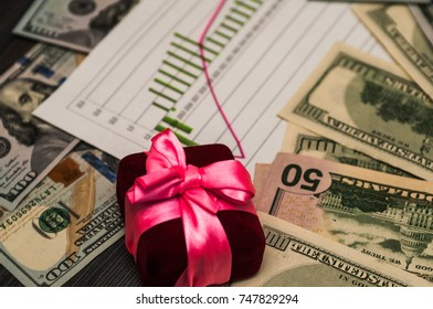 A bunch of US dollars in a pink ribbon, a beautiful background.