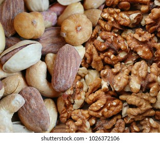 a bunch of various nuts, almonds, hazelnuts, walnuts, pistachios. collage