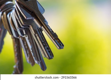 A bunch of vintage keys over the open window with green background