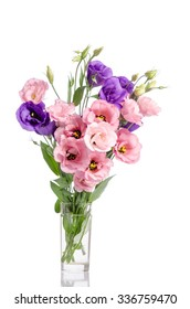 bunch of violet and pink eustoma flowers in glass vase isolated on white