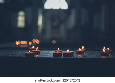 A bunch of votive candles burning in a church