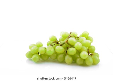 a bunch of white grapes on white
