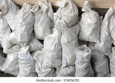 Bunch of White Sacks With Rubble at Street