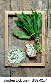 Bunch of wild garlic on a wooden table