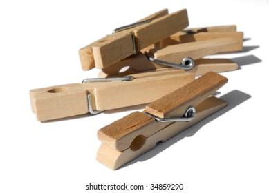 bunch of wooden clothespins isolated on white
