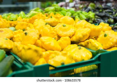Bunch of yellow Pattypan squashes in supermarket