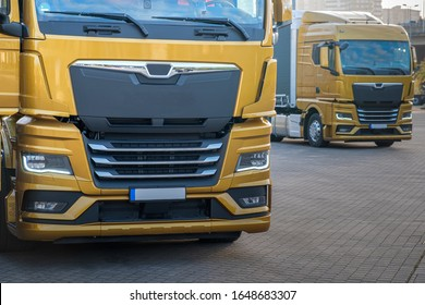 a bunch of yellow trucks (same model) parked in a row