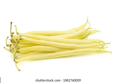 Bunch of yellow wax beans on a white background
