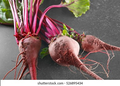 Bunch of young beets on grey background