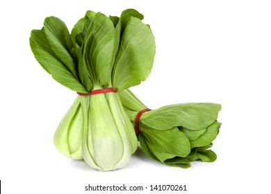 Bunches of bok choy, isolated on white background. Asian leafy green vegetable.