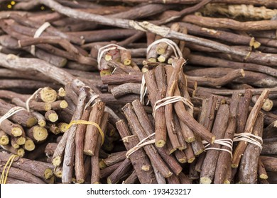 Bunches of licorice tied with a rope, exposed for sale at a fair