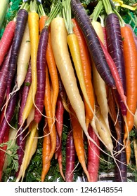 Bunches of multi color carrots at a farmers market