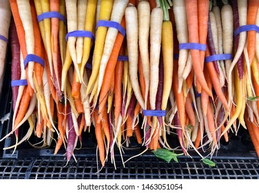 Bunches of rainbow carrots at the market