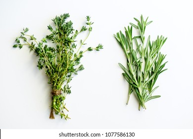 Bunches of tied thyme and rosemary on white background isolated
