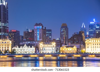 The bund of Shanghai huangpu river of tall buildings in the evening.