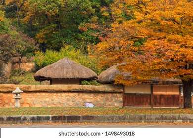 Bundang Junganggongwon Park(Central Park) in Seongnam-si, Korea - October, 2018 : It is the magnificent fall scenery. It is traditional Korean thatched roof house there.