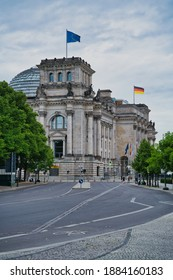Bundestag building in Berlin, Germany with EU and German flags on display