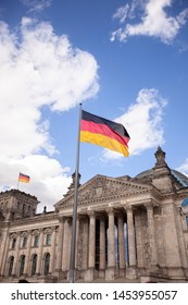 The Bundestag with the german flag waving, Berlin, Germany