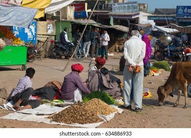Bundi, India - February 11, 2017: People and vegetable vendors in a street market at Bundi, Rajasthan, India.