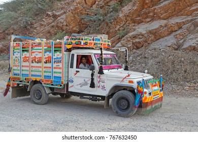 BUNDI, INDIA, November 7, 2017 : A painted and colored truck drives on a poor road of Rajasthan