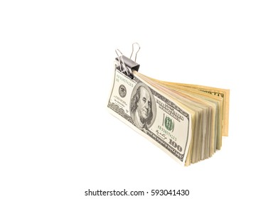 Bundle of banknotes in a clamp