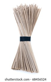 Bundle of buckwheat soba noodles. Isolated on white.