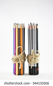 Bundle of coloured pencils tied together with jute twine