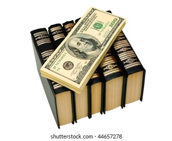 Bundle Of Dollars On The Books On White Background