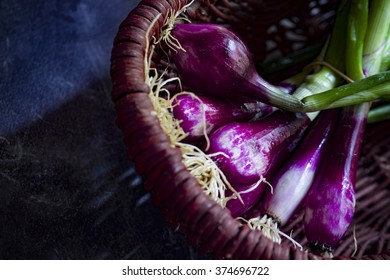 Bundle of fresh red Scallions in a basket