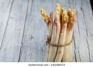 Bundle of Fresh unpeeled white Asparagus in Spring